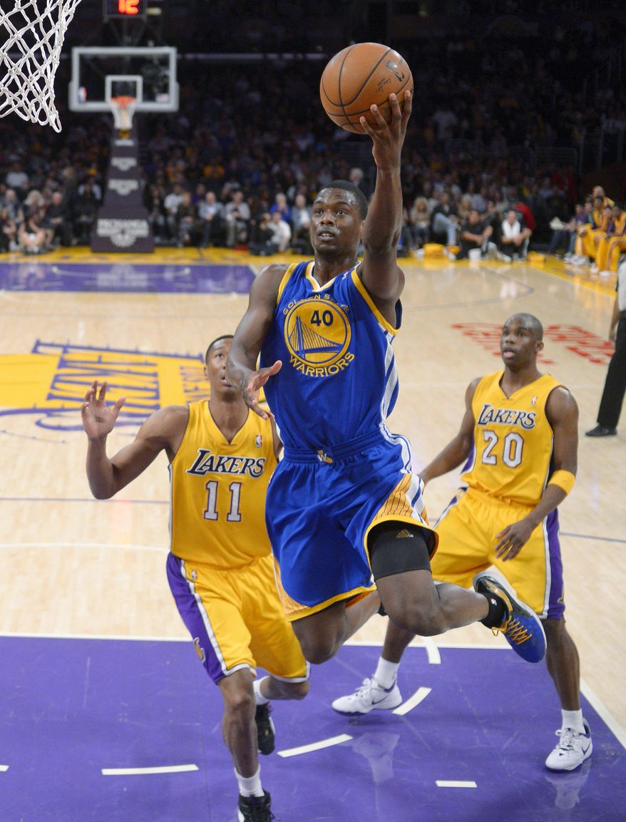 Golden State Warriors forward Harrison Barnes, center, goes up for a shot as Los Angeles Lakers forward Wesley Johnson, left, and guard Jodie Meeks defend during the first half of an NBA basketball game, Friday, April 11, 2014, in Los Angeles. (AP Photo/Mark J. Terrill)