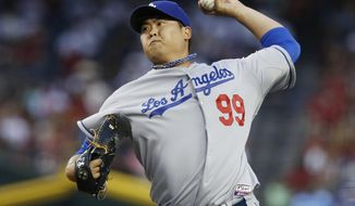 Los Angeles Dodgers' Hyun-Jin Ryu, of South Korea, throws a pitch against the Arizona Diamondbacks during the first inning of a baseball game on Friday, April 11, 2014, in Phoenix. (AP Photo/Ross D. Franklin)