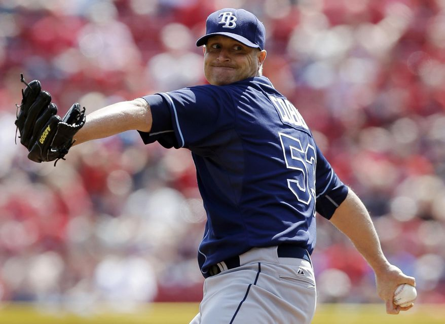 Tampa Bay Rays starting pitcher Alex Cobb throws against the Cincinnati Reds in the first inning of a baseball game, Saturday, April 12, 2014, in Cincinnati. (AP Photo/Al Behrman)