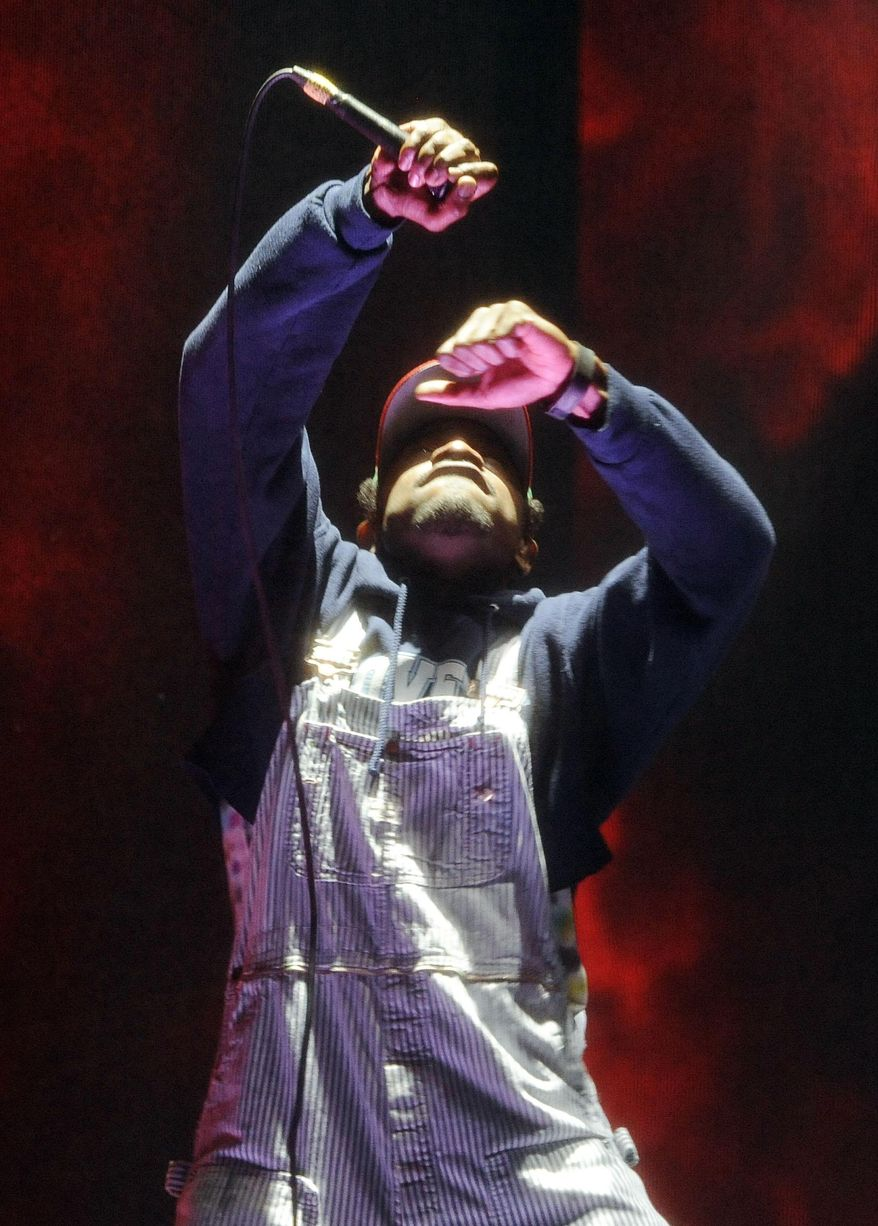 Andre 3000 of hip hop group Outkast performs during their headlining set on the first day of the 2014 Coachella Music and Arts Festival on Friday, April 11, 2014, in Indio, Calif. (Photo by Chris Pizzello/Invision/AP)