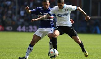 Sampdoria defender Angelo Palombo, left, and Inter Milan forward Mauro Emanuel Rivero Icardi battle for the ball during a Serie A soccer match, in Genoa, Italy, Sunday, April 13, 2014. (AP Photo/Carlo Baroncini)