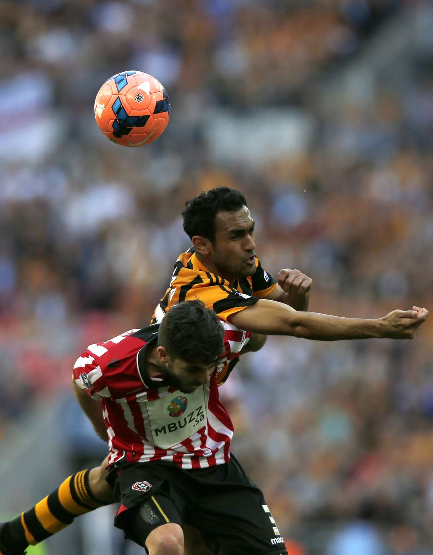 Hull City's Ahmed Elmohamady, right, competes with Sheffield United's Robert Harris during their English FA Cup semifinal soccer match at Wembley Stadium in London, Sunday, April 13, 2014. (AP Photo/Sang Tan)