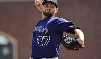 Colorado Rockies starting pitcher Tyler Chatwood throws to the San Francisco Giants during the first inning of a baseball game on Sunday, April 13, 2014, in San Francisco. (AP Photo/Marcio Jose Sanchez)