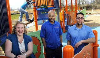 "ADVANCE FOR SUNDAY, APRIL 13 - In this photo taken on April 3, 2014, from left, Emily Guill, of Roanoke, Va., Rudy Banks of Christiansburg, Va. and Jonathan Holmes of Christiansburg, Va. pose for a photo at a children's playground in Roanoke, Va. The trio released ""Kidz Play,"" which is easily the most soulful children's CD that's been recorded in these parts. (AP Photo/The Roanoke Times, Rebecca Barnett)"