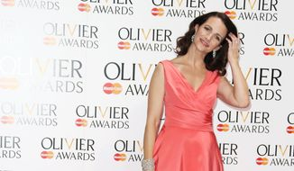 US actress Kristin Davis poses for photographs backstage after presenting Best Director to Lyndsey Turner during the Olivier Awards at the Royal Opera House in central London, Sunday, April 13, 2014.  Named after the British actor Laurence Olivier, the awards are given for productions staged in London. (Photo by Joel Ryan/Invision/AP Images)