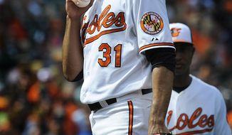 Baltimore Orioles pitcher Ubaldo Jimenez pauses in the sixth inning of a baseball game against Toronto Blue Jays, Sunday, April 13, 2014, in Baltimore. (AP Photo/Gail Burton)