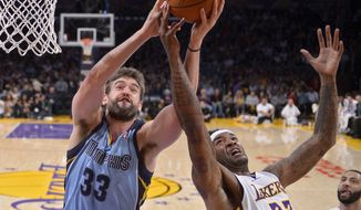 Memphis Grizzlies center Marc Gasol, left, of Spain, and Los Angeles Lakers forward Jordan Hill battle for a rebound during the first half of an NBA basketball game, Sunday, April 13, 2014, in Los Angeles.  (AP Photo/Mark J. Terrill)