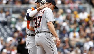 Detroit Tigers catcher goes out to the mound to confer with starting pitcher Max Scherzer during fourth inning play of a baseball game against the San Diego Padres Sunday, April 13, 2014, in San Diego. (AP Photo/Don Boomer)