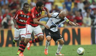 Vasco's Pablo Guinazu, right, fights for the ball with Flamengo's Wallace during the Rio de Janeiro state championship final soccer match at Maracana stadium in Rio de Janeiro, Brazil, Sunday, April 13, 2014. (AP Photo/Leo Correa)