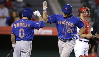 New York Mets' Anthony Recker (20) celebrates his home run with Omar Quintanilla during the 13th inning of a baseball game against the Los Angeles Angels on Saturday, April 12, 2014, in Anaheim, Calif. (AP Photo/Jae C. Hong)