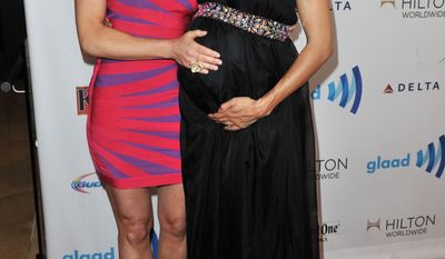 Teri Polo, left, and Sherri Saum arrive at the 25th Annual GLAAD Media Awards on Saturday, April 12, 2014. (Richard Shotwell/Invision/AP)