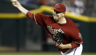 Arizona Diamondbacks' Trevor Cahill delivers a pitch against the Los Angeles Dodgers during the first inning of a baseball game on Sunday, April 13, 2014, in Phoenix. (AP Photo/Ralph Freso)