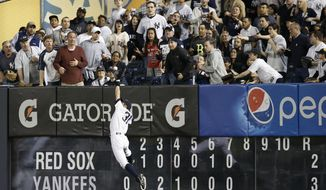 Baseball fans watch as New York Yankees  right fielder Ichiro Suzuki (31) catches an eighth-inning flyout by Boston Red Sox designated hitter David Ortiz, robbing Ortiz of a game-tying home run, in the MLB American League baseball game at Yankee Stadium in New York, Sunday, April 13, 2014.  (AP Photo/Kathy Willens)