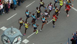Athletes lead shortly after the start of the Vienna city marathon, in Vienna, Austria, on Sunday, April 13, 2014. (AP Photo/Ronald Zak)