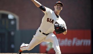 San Francisco Giants starter Tim Hudson throws to the Colorado Rockies during the first inning of a baseball game on Sunday, April 13, 2014, in San Francisco. (AP Photo/Marcio Jose Sanchez)