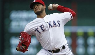 Texas Rangers starting pitcher Martin Perez delivers a pitch to the Houston Astros during the first inning of a baseball game, Sunday, April 13, 2014, in Arlington, Texas. (AP Photo/Jim Cowsert)