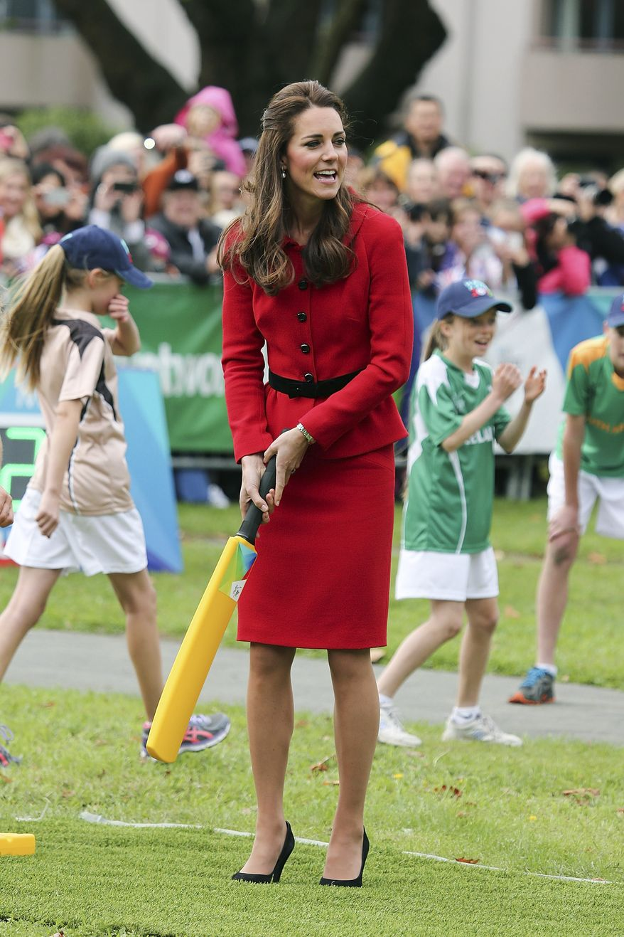 Britain's Kate, the Duchess of Cambridge, plays cricket in Latimer Square in Christchurch, New Zealand, Monday, April 14, 2014. The royal couple are on a three-week tour of New Zealand and Australia with their son, Prince George. (AP Photo/Martin Hunter, Pool)
