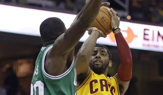 Cleveland Cavaliers' Kyrie Irving (2) shoots over Boston Celtics' Brandon Bass (30) during the second quarter of an NBA basketball game Saturday, April 12, 2014, in Cleveland. Boston defeated Cleveland 111-99. (AP Photo/Tony Dejak)
