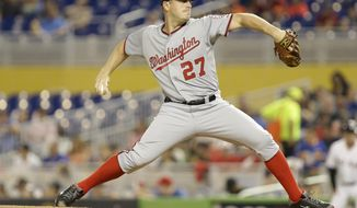 Washington Nationals starting pitcher Jordan Zimmermann (27) throws during the first inning of the MLB National League  baseball game against the Miami Marlins, Monday, April 14, 2014, in Miami. (AP Photo/Lynne Sladky)