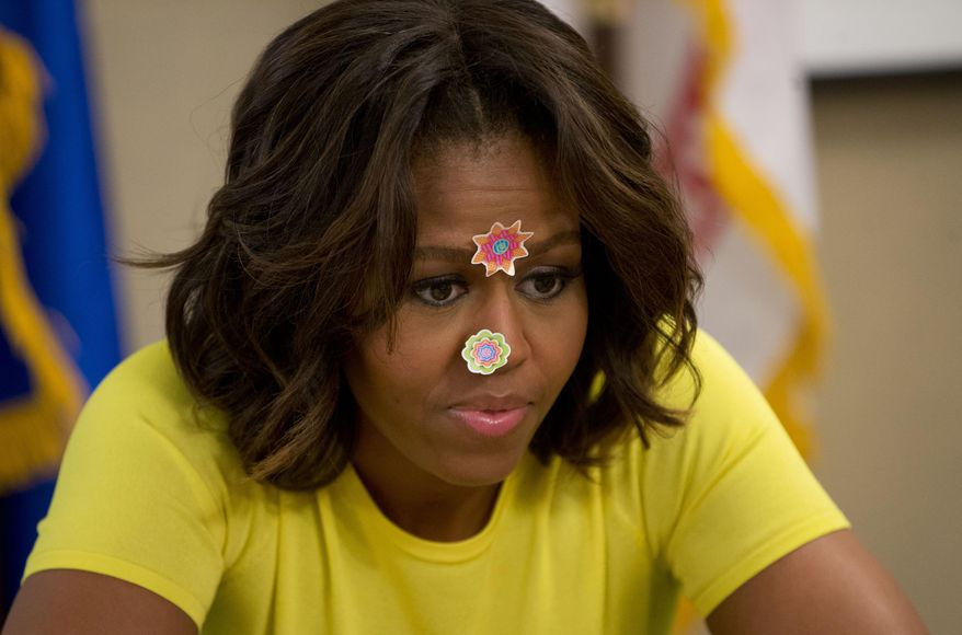 First lady Michelle Obama wears stickers on her face that where placed on her by 20-month-old Lily Oppelt, from Indiana, during her visit with Wounded Warriors being cared for at the Fisher House at Walter Reed National Military Medical Center in Bethesda, Md., Monday, April 14, 2014. The first lady is participating in a pre-Easter celebration with military families and their children. The Fisher House provides extend stay housing program for family members while their loved ones receiving specialized medical care at Walter Reed. (AP Photo/Pablo Martinez Monsivais)