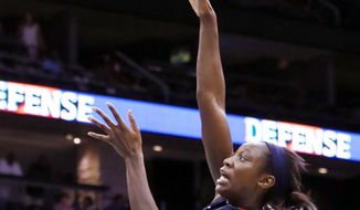 FILE - In an Aug. 16, 2012, file photo Connecticut Sun center Tina Charles goes up for a basket against the New York Liberty during the second half of a WNBA basketball game at the Prudential Center in Newark, N.J.  People familiar with the situation say the Connecticut Sun have agreed to trade Tina Charles to New York for players to be named later and the Liberty's first round pick in 2015. (AP Photo/John Minchillo, File)