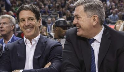 Toronto Maple Leafs new President Brendan Shanahan, left,  sits with Maple Leafs Sports Entertainment CEO Tim Leiweke as they watch first half NBA basketball action between the Toronto Raptors and the Milwaukee Bucks in Toronto on Monday, April 14, 2014. (AP Photo/The Canadian Press, Chris Young)