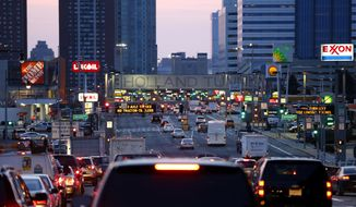 Traffic flows toward the Holland Tunnel, Monday, April 14, 2014, in Jersey City, N.J. (AP Photo/Julio Cortez) ** FILE **