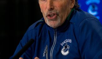 Vancouver Canucks' head coach John Tortorella responds to questions during an end of season news conference in Vancouver, British Columbia on Monday April 14, 2014.  The Canucks missed the playoffs this year.  (AP Photo/The Canadian Press, Darryl Dyck)