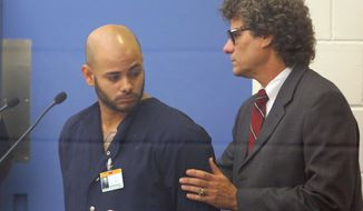 Robert Corchado appears with his attorney Daniel Tumarkin in front of Senior Judge Thomas Kirkland at the Orange County Booking and Release Center on a bond hearing in Orlando, Fla. Monday, April 14, 2014.  Kirkland has set bail at $100,000 for Corchado, accused in a crash that killed a 4-year-old girl and injured 14 people at a central Florida daycare center. Prosecutors sought to raise 28-year-old Robert Corchado's bail to $250,000 during the Monday morning hearing.  (AP Photo/Orlando Sentinel, Pool)