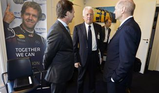 Red Bull technical director Adrian Newey, right, and Red Bull team principal Christian Horner, left, talk with Charlie Whiting, center, International Automobile Federation (FIA) Race Director, during an FIA Appeal Court hearing, Paris, Monday, April 14, 2014. The dispute resolution tribunal for motorsport is hearing Red Bull's case against the disqualification of Daniel Ricciardo from the Australian Grand Prix. (AP Photo/Eric Vargiolu, Pool)