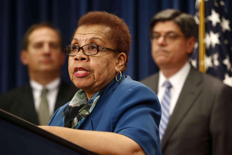 ** FILE ** In this May 31, 2013, file photo, acting Social Security Commissioner Carolyn W. Colvin, center, accompanied by Acting Labor Secretary Seth D. Harris, left, and Treasury Secretary Jacob Lew, speaks during a news conference about Social Security and Medicare in Washington. (AP Photo/Charles Dharapak, File)