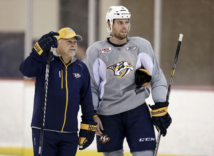 FILE - In this Sept. 13, 2013, file photo, Nashville Predators head coach Barry Trotz talks with defenseman and team captain Shea Weber, right, during an NHL hockey training camp in Nashville, Tenn. The Predators announced Monday, April 14, 2014, that Trotz's contract will not be renewed and the team will begin looking for a new head coach. (AP Photo/Mark Humphrey, File)