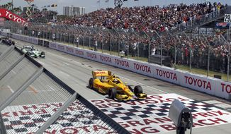 Ryan Hunter-Reay (28) starts the race with Sebastien Bourdais, of France, from a standing start, then took the lead for fifty-one laps until crashing in the IndyCar Grand Prix of Long Beach auto race on Sunday, April 13, 2014, in Long Beach, Calif. Mike Conway, of England, won the race. (AP Photo/Alex Gallardo)