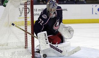 FILE - In this April 8, 2014, file photo, Columbus Blue Jackets' Sergei Bobrovsky, of Russia, defends the goal against the Phoenix Coyotes in an NHL hockey game in Columbus, Ohio. The Blue Jackets, playing in the postseason for only the second time in franchise history, open the Stanley Cup playoffs at the Pittsburgh Penguins, Wednesday, April 16, 2014. (AP Photo/Jay LaPrete, File)