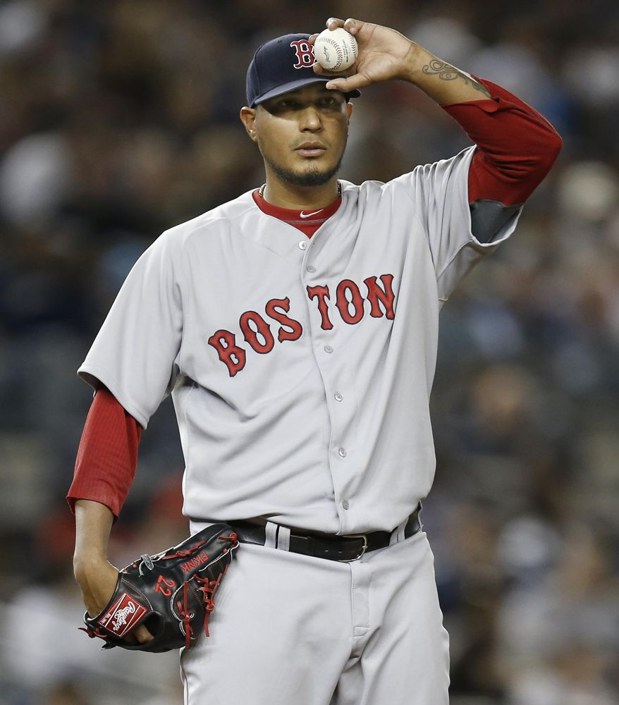 Boston Red Sox starting pitcher Felix Doubront pauses to check the runner on first in the fifth inning of a baseball game against the New York Yankees at Yankee Stadium in New York, Sunday, April 13, 2014.  (AP Photo/Kathy Willens)