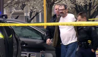 In this Sunday, April 13, 2014 image from video provided by KCTV-5, Frazier Glenn Cross, also known as Frazier Glenn Miller, is escorted by police in an elementary school parking lot in Overland Park, Kan. Cross, 73, accused of killing three people in attacks at a Jewish community center and Jewish retirement complex near Kansas City, is a known white supremacist and former Ku Klux Klan leader who was once the subject of a nationwide manhunt. (AP Photo/KCTV-5) MANDATORY CREDIT