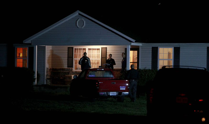Members of the ATF and FBI search a house belonging to Fraiser Glenn Cross, also known as Frazier Glenn Miller, near Marionville, Mo., The Lawrence County Mo. sheriff and Missouri State Highway Patrol are also on the scene. (AP Photo/Springfield News-Leader, Nathan Papes)