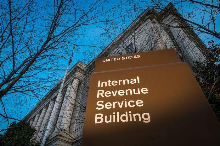 ** FILE ** This photo taken April 13, 2014, shows the headquarters of the Internal Revenue Service (IRS) in Washington at daybreak. (AP Photo/J. David Ake)