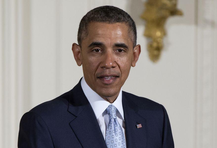 President Barack Obama speaks during the Easter Prayer Breakfast, Monday, April 14, 2014, in the East Room of the White House in Washington. (AP Photo/Carolyn Kaster)