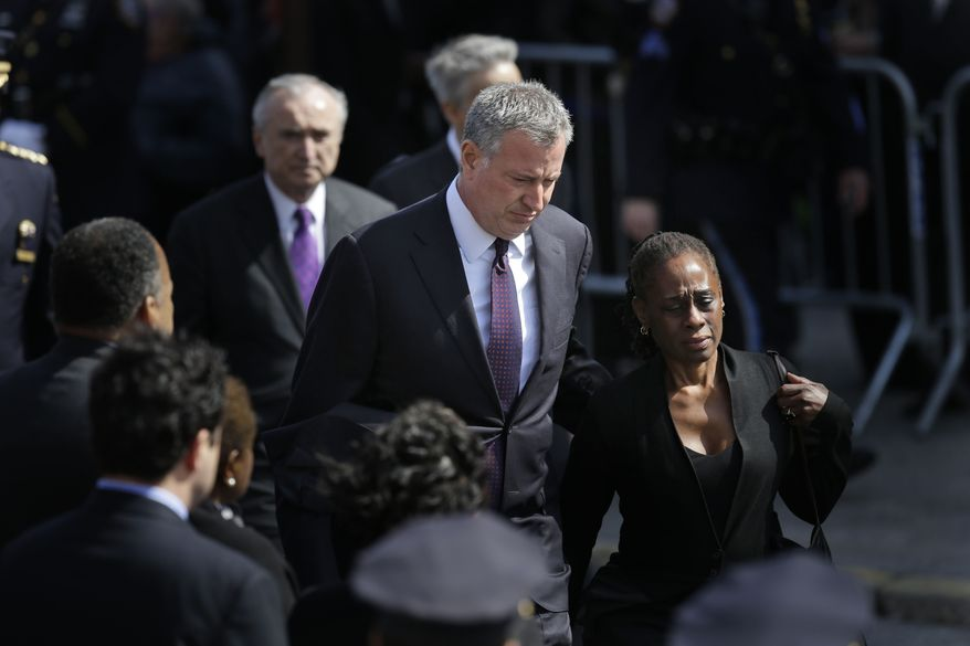 New York City Mayor Bill de Blasio and his wife Chirlane McCray arrive for the funeral of Officer Dennis Guerra in the Rockaway Beach section of New York, Monday, April 14, 2014.  Guerra died Wednesday after being overcome by smoke from a Brooklyn mattress fire. He was the first NYPD officer killed in the line of duty since 2011. His partner remains in critical but stable condition. (AP Photo/Seth Wenig)