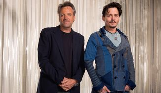 """This Saturday, April 5, 2014 photo shows actor Johnny Depp, right, and director Walter Pfister during the """"Transcendence"""" film press junket at the Four Seasons Hotel, in Los Angeles. For more than a decade the cinematographer Pfister has been bringing director Christopher Nolan's cinematic visions to life, but now he's the one calling the shots. His directorial debut """"Transcendence"""" has many elements of a Nolan blockbuster, with eye-popping visual effects, a mind-bending story and an A-list lead in Depp. (Photo by Zach Cordner/Invision/AP)"""