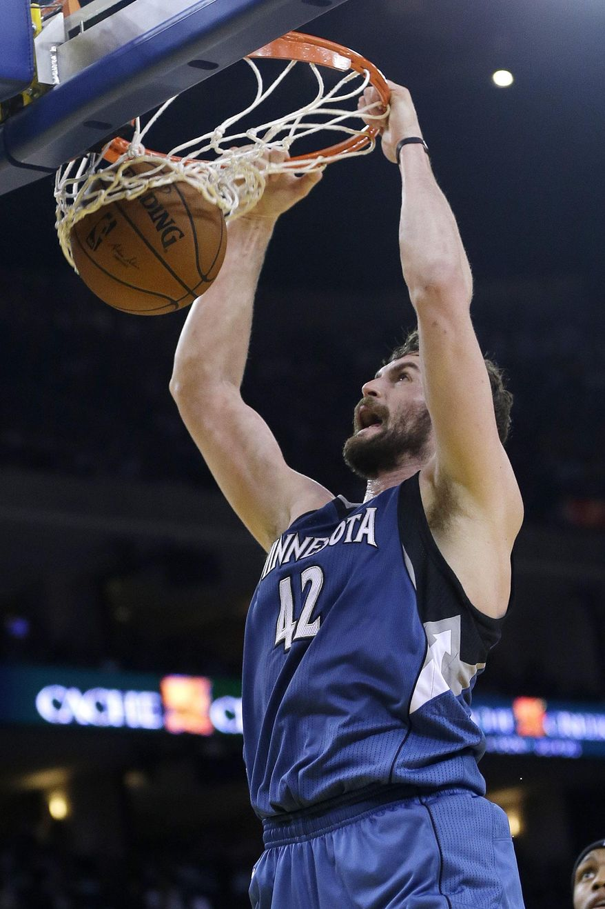 Minnesota Timberwolves' Kevin Love (42) dunks against the Golden State Warriors during the first half of an NBA basketball game on Monday, April 14, 2014, in Oakland, Calif. (AP Photo/Marcio Jose Sanchez)