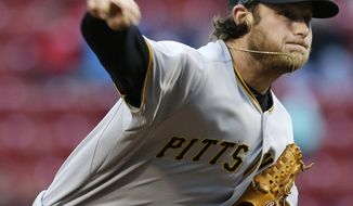 Pittsburgh Pirates starting pitcher Gerrit Cole throws against the Cincinnati Reds in the first inning of a baseball game, Tuesday, April 15, 2014, in Cincinnati. (AP Photo/Al Behrman)