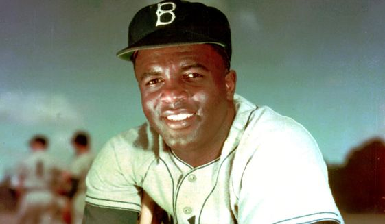 FILE - In this 1952 file photo, Brooklyn Dodgers baseball player Jackie Robinson poses. Baseball holds tributes across the country on Jackie Robinson Day, Tuesday, April 15, 2014, the 67th anniversary marking the end of the game's racial barrier. (AP Photo/File) **FILE**