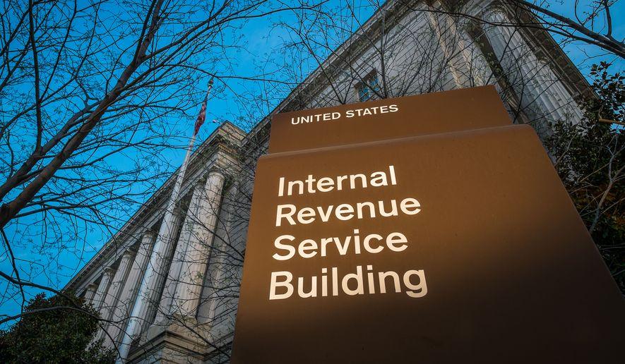 This April 13, 2014, file photo shows the headquarters of the Internal Revenue Service (IRS) in Washington. (AP Photo/J. David Ake, File)