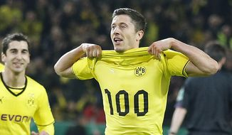 Dortmund's Robert Lewandowski of Poland, right, celebrates with Dortmund's Henrikh Mkhitaryan of Armenia, left, after scoring during the German soccer cup (DFB Pokal) semifinal match between BvB Borussia Dortmund and VfL Wolfsburg Tuesday, April 15, 2014 in Dortmund, Germany. (AP Photo/Frank Augstein)