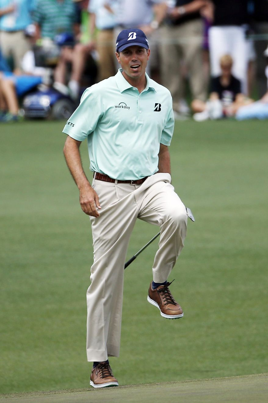 Matt Kuchar reacts as he narrowly misses a putt on the second green during the fourth round of the Masters golf tournament Sunday, April 13, 2014, in Augusta, Ga. (AP Photo/Matt Slocum)