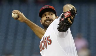 Arizona Diamondbacks' Josh Collmenter throws a pitch against the New York Mets in the first inning of a baseball game on Monday, April 14, 2014, in Phoenix. (AP Photo/Ross D. Franklin)