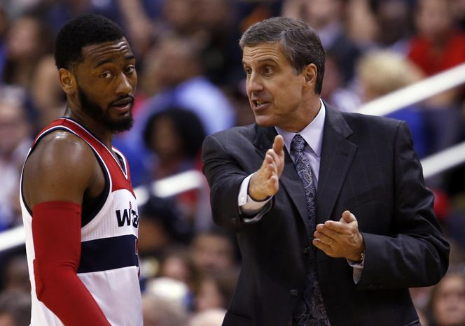 Washington Wizards guard John Wall listens to head coach Randy Wittman in the second half against the Miami Heat on Monday. The playoff-bound Wizards have surprisingly moved to the head of the class in the D.C. sports landscape.