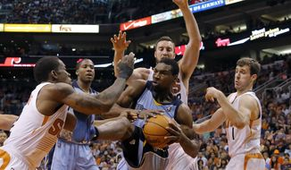 Memphis Grizzlies' Tony Allen, center, is pressured by Phoenix Suns' Eric Bledsoe, left, Miles Plumlee, rear, and Goran Dragic, of Slovenia, during the first half of an NBA basketball game, Monday, April 14, 2014, in Phoenix. (AP Photo/Matt York)